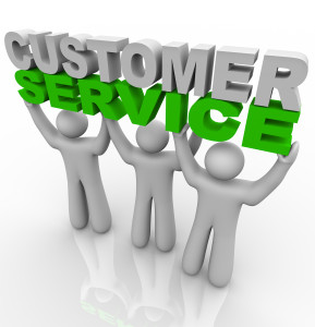 Three customer service representatives lift the words